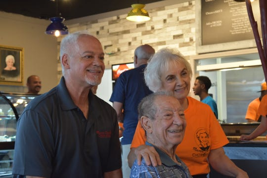 "Jack Baudo and Sharon Baudo-Smith pose with their father Basil ""Buzz"" Baudo at Mama Baudo's Chow Bella in Jackson, Tenn. during the restaurant's soft opening on Sept. 26, 2019."