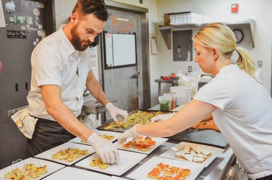 Chefs Brian and Jessica Strutz of A Dopo Sourdough Pizza prepare some dishes. April 28, 2019.