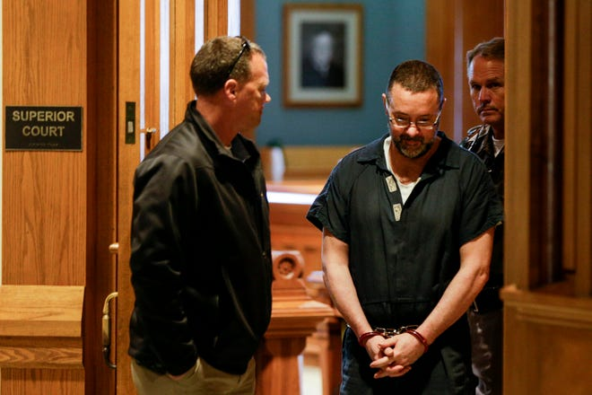 Patrick Elliott is escorted out the Tippecanoe County Courthouse by sheriff's deputies afterbeing sentenced to 75 years in prison by Superior Court Judge Randy Williams, Thursday, Sept. 26, 2019 in Lafayette. Elliott, 53, was found guilty in the Aug. 2017 killing his wife, Donita Elliott.