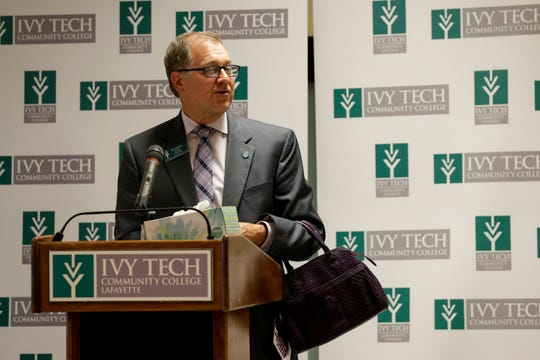 "Dr. John Laws, vice chancellor for Student Affairs, holds a purple pursue as he speaks during a YWCA ceremony proclaiming October ""Domestic Violence Awareness Month,"" Thursday, Sept. 26, 2019 at Ivy Tech Community College in Lafayette."