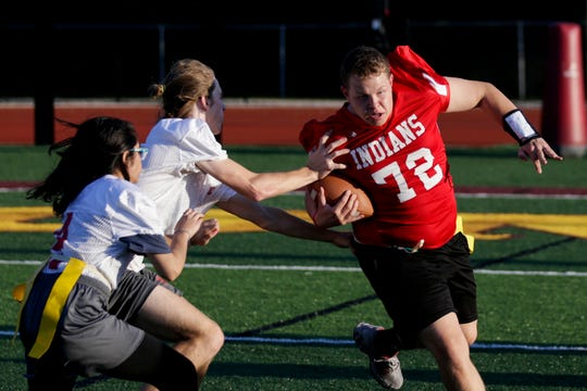 Twin Lakes' Reece Bartlett (72) dodges two West Lafayette players as he runs the ball during an IHSAA unified flag football game, Wednesday, Sept. 25, 2019, at McCutcheon High School in Lafayette.