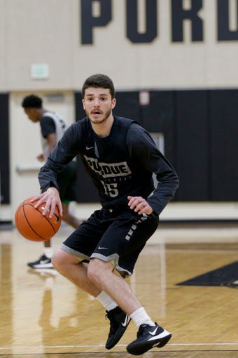 Purdue guard Tommy Luce (15) dribbles during a basketball practice, Wednesday, Sept. 25, 2019, at Mackey Arena's Cardinal Court in West Lafayette.