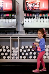 Sofia Cabral, 4, takes a sip of her Den Pop at the new Discount Den location, 618 W Stadium ave., Thursday, Sept. 26, 2019, in West Lafayette.