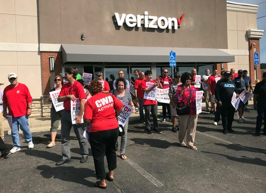 About 50 people protested at the Verizon Wireless store at 1926 N. Memorial Drive Thursday in support of former employee Martin Hopkins. Hopkins said he was fired on June 13 over racial issues and because he wanted to start a union at the store.