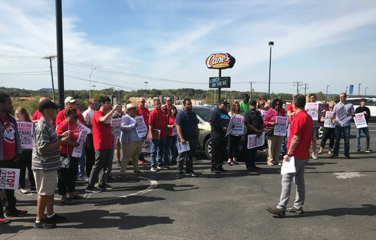 Communications Workers of America's Tim Dubnau addresses protesters at the Verizon Wireless store at 1926 N. Memorial Drive. The protesters demanded the company rehire former employee Martin Hopkins, who said he was fired June 13 because of racism and wanting to start a union.