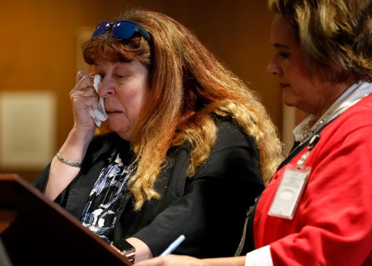 Cristine Letourneau, left, wipes tears from her eyes as she talks about the impact the murder of her husband John Peter Letourneau had on her and her daughter. Cristine Letourneau was speaking at the sentencing hearing of Raeqwan Jahmell Hancock, who was found guilty of John Letourneau's death, Thursday afternoon, Sept. 26, 2019, in Fairfield County Common Pleas Court in Lancaster. Fairfield County Prosecutor's Office victim assistance specialist Misty Richardson is at right.