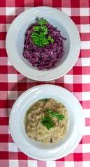 Side dishes, red cabbage, top , and sauerkraut, bottom, at Gasthaus Restaurant. Sept. 25, 2019.