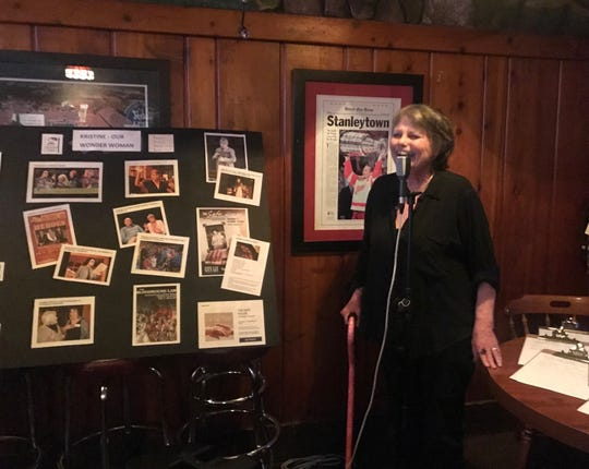 """Kristine Thatcher thanks her friends and family at Stober's bar Sept. 23, 2019. The bar was owned by her grandparents and plays a role in the upcoming play """"The Safe House"""" by Thatcher. it opens Oct. 3 at the Williamston Theatre."""