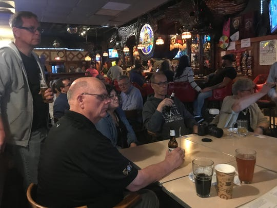 Dan Schneider, a cousin of Kristine Thatcher, is among the crowd of friends and relatives at Stober's bar celebrating Thatcher's play Sept. 23, 2019. The play opens Oct. 3.