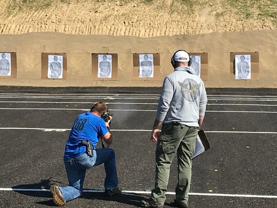Members of the Mansfield Police Department practice at the city's new police shooting range on Miller Parkway.