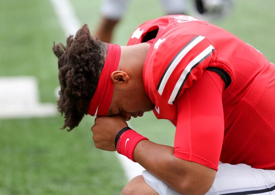 Ohio State quarterback Justin Fields alone with his thoughts before the season opener with Florida Atlantic.