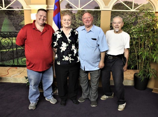 The Central Ohio Association of Christian Broadcasters (COACB) recently completed the purchase of television station WQIZ in Ashland from Christian Faith Broadcasting based in Castalia. Members of the COACB staff are, from left, General Manager Jonathan Aiken, Carolyn Aiken, President David Aiken, and Dick Haines.