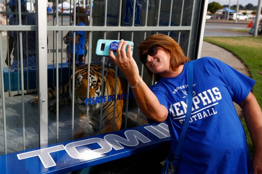 Memphis fan Susan Meadors takes a selfie with Tom III before the Tigers play their game against Navy at the Liberty Bowl Memorial Stadium on Thursday, September 26, 2019.