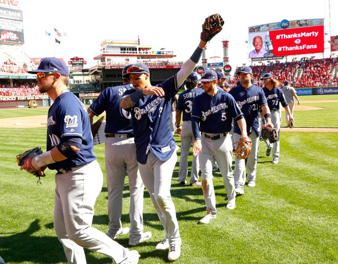 Sep 26, 2019; Cincinnati, OH, USA; The Milwaukee Brewers walk off the field after defeating the Cincinnati Reds at Great American Ball Park. Mandatory Credit: David Kohl-USA TODAY Sports