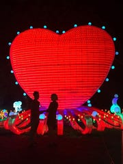 Erik Griggs proposed to Jackie Silvis at the heart display at China Lights.