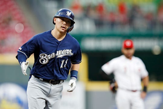 Keston Hiura rounds the bases after a solo home run in the second inning.