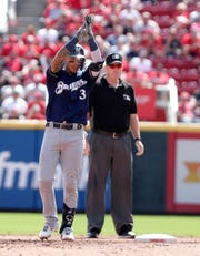 Brewers shortstop Orlando Arcia celebrates his three-run double in the fourth inning against the Reds on Thursday.