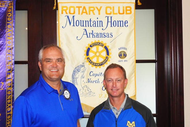 """Rotarian of the Day Mike Stockton (left) introduced Mountain Home High School Athletic Director Mitch Huskey as his guest speaker on Sept. 12 at the Rotary Club of Mountain Home.Huskey, a MHHS graduate, gave the club a run-down of all the different sports that are available for boys and girls in our schools.Huskey told the club about the eightdistrict and state runner-up titles won this past year in soccer, cross-country, bowling, swimming, track, tennisand girls' golf. He said that, besides winning in the classroom and on the field/courts, their goal as coaches is to teach these young people to """"win in life"""" through character and discipline.Head football coach, Bryan Mattox, also a MHHSgrad, talked about their schedule and the community support they get for both their academic and athletic endeavors.Besides a great program and several guests, the club inducted a new member, Scott Booth from Ideal Weight Loss Center."""