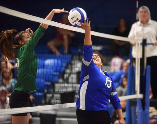 Cotter setter Ashley Garay attempts a tip during a recent match against Yellville-Summit at Cotter.