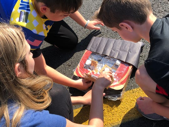 Ms. Vonya Schaufler and Mrs. Katie Henderson and their sixth grade science classes benefitted from a MHEF Teaching Grant in September when they measured increasing temperatures in their solar ovens with infrared laser thermometers. The Foundation granted Schaufler the funds to purchase the thermometers and the food supplies for this innovative, collaborative learning opportunity! At the end of the outdoor lab experience, the students got to enjoy their finished products: S'Mores! Schaufler mentioned how grateful she was to the Foundation, because without this grant, projects like this would not be possible. For information on donating to grants like this, visit https://www.mountainhomeeducationfoundation.com/to-teacher-grants.html.