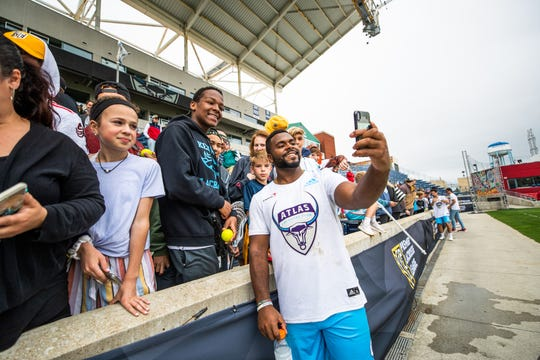 Trevor Baptiste, a Morristown-Beard alumnus and Atlas' faceoff specialist, poses with fans after a game against the Chrome.