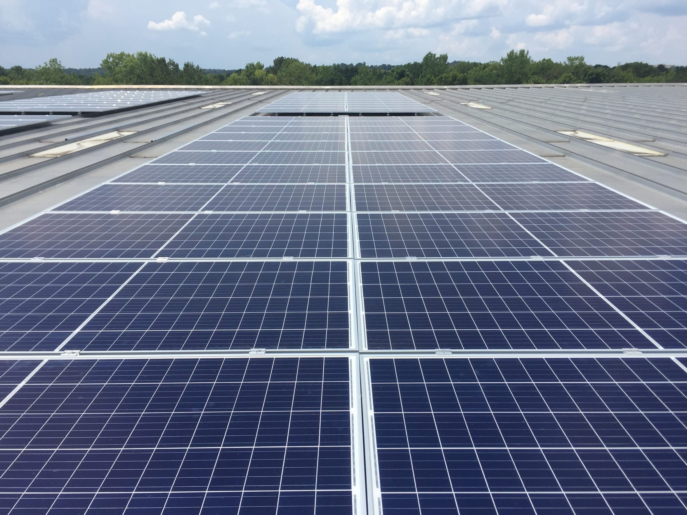 Solar panels on a warehouse owned by Joe Piper, Inc. in Midfield, Ala. CEO Ann Piper says she expects the panels to save about $5,000 a month in electric bills.