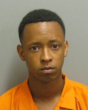 Tawaine McCullough was charged with first-degree robbery an theft.