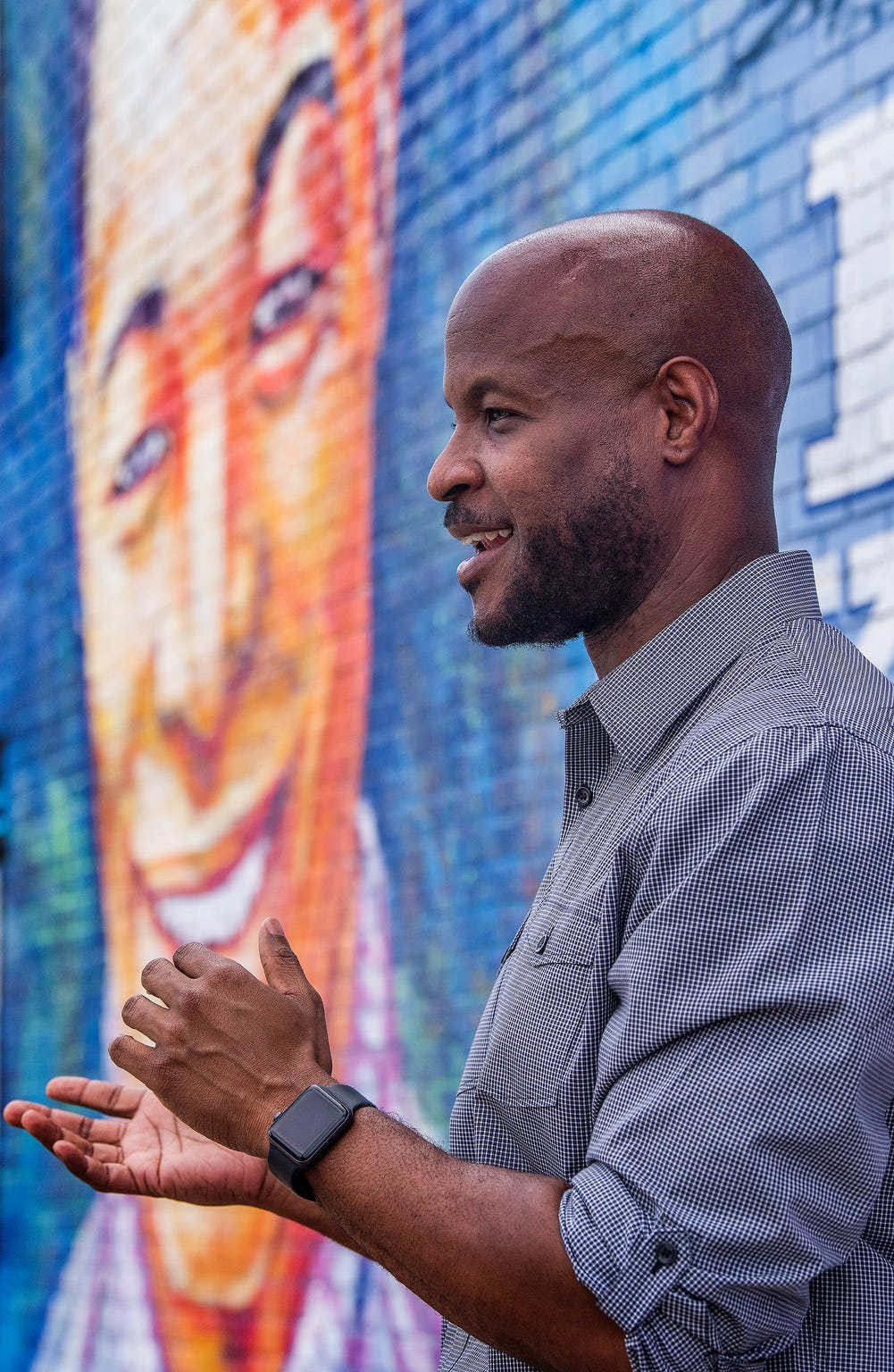 21 Dreams founder Kalonji Gilchrist talks about art projects in Montgomery as he stands in front of the Nat King Cole mural in Montgomery, Ala., on Thursday September 26, 2019.
