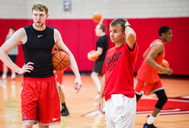 Ball State men's basketball coach James Whitford and freshman center Ben Hendriks watch practice at the Dr. Don Shondell Practice Center.