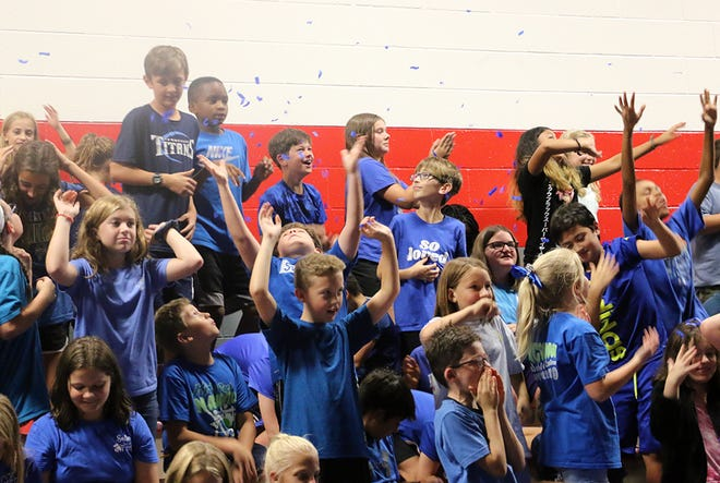 Go blue! McFadden School of Excellence students celebrate their school's designation as a National Blue Ribbon School for 2019.