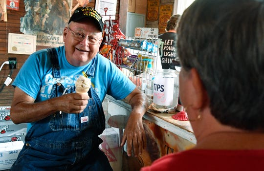 "Bud and Fay Clemons enjoy a scoop of ice cream after lunch at T.B. Sutton General Store in Granville, Tenn. The store is at the heart of the revitalization going on in Granville. The store hosts the ""Sutton Ole Time Music Hour,"" which broadcasts live bluegrass music all over the world on Saturday nights."
