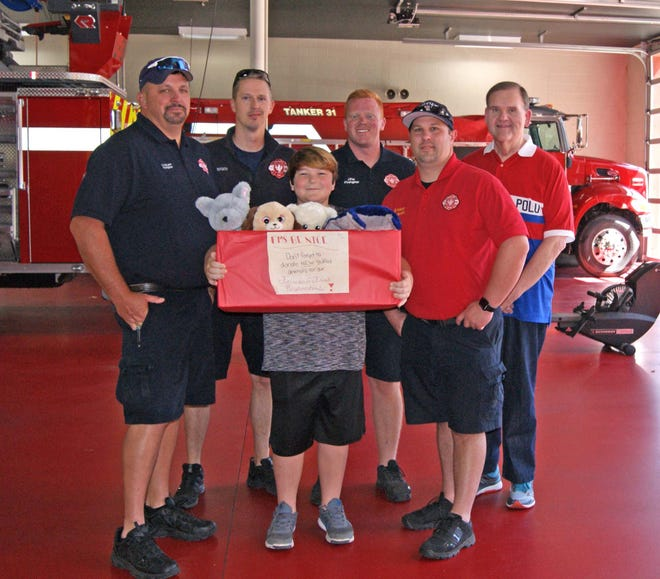 Fairview Middle School student Kyle delivered his first stuffed animal donations to Mayor John Blade and Fairview Firefighters on Sept. 21, 2019.