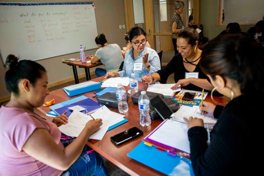 Women in the Beginnings 201 class work on learning to describe their daily routines in English at Grace Place in Golden Gate on Wednesday, September 25, 2019.