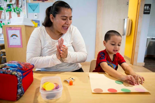 Ana Leon works with her son, David Henriquez, on a color-matching craft during parent and child together time at Grace Place in Golden Gate on Wednesday, September 25, 2019.