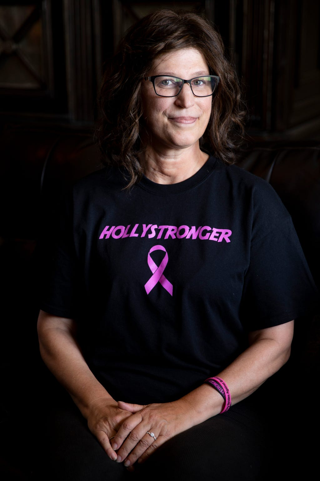 Holly DiGilarmo poses for a portrait at her home in Bonita Springs on Wednesday, September 25, 2019. DiGilarmo was diagnosed with stage two breast cancer in 2018 and has undergone multiple surgeries, chemotherapy, and radiation treatment since then.