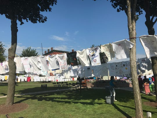 Two thousand shirts made by survivors of violence hung on The Green in Hackensack as part of YWCA's annual Clothesline Project.