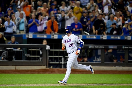 Pete Alonso #20 of the New York Mets runs the bases after hitting a home run, his 51st of the season, in the second inning of their game against the Miami Marlins at Citi Field on September 25, 2019 in New York.