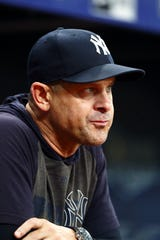 Sep 25, 2019; St. Petersburg, FL, USA; New York Yankees manager Aaron Boone (17) looks on during the third inning against the Tampa Bay Rays at Tropicana Field. Mandatory Credit: Kim Klement-USA TODAY Sports