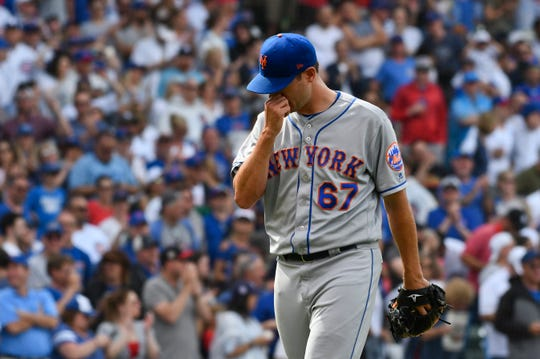 New York Mets relief pitcher Seth Lugo leaves after being relieved during the eighth inning of a baseball game against the Chicago Cubs, Sunday, June 23, 2019, in Chicago.