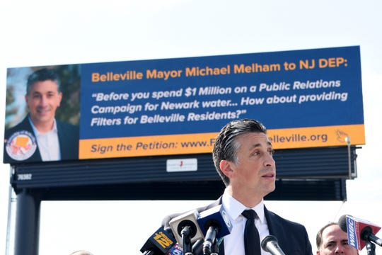 Belleville Mayor Michael Melham unveils a billboard, along Rt. 21, asking New Jersey Department of Environmental Protection provide water filters to nearly 40,000 Belleville residents who drink the same Pequannock-based Newark water through 6,000 residential lead service lines. Melham held a press conference on September 26, 2019.