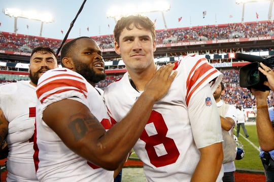 Sep 22, 2019; Tampa, FL, USA; New York Giants quarterback Daniel Jones (8) and running back Elijhaa Penny (39) hug after defeating the Tampa Bay Buccaneers at Raymond James Stadium.