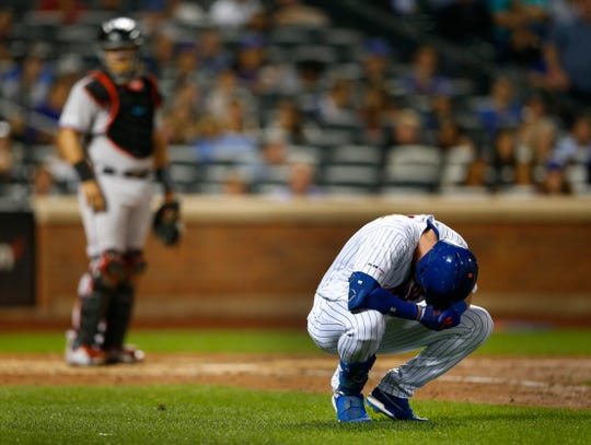Sep 25, 2019; New York City, NY, USA;  New York Mets left fielder Jeff McNeil (6) reacts after being hit by a pitch against the Miami Marlins in the sixth inning at Citi Field.