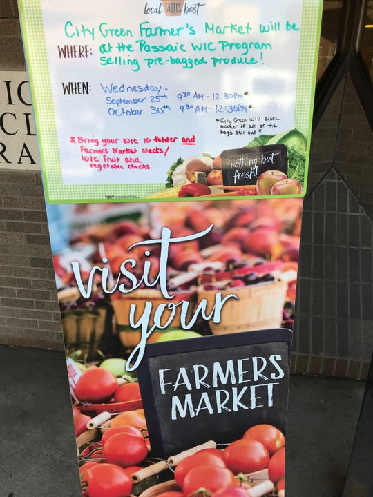 Sign in front of Passaic City Hall letting those who get food assistance that once a month their farmer's market food vouchers earn double their buying power.