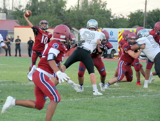 The Wildcat passing game is progressing and creating more of a balanced attack on offense. Here, Manuel Antonio Aguilar (10) spots receiver Jordan Caballero (foreground) on a slant pattern against Santa Fe Capital.