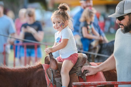 A child rides a horse at the Southern New Mexico State Fair & Rodeo in Las Cruces on Thursday, Sept. 26, 2019.