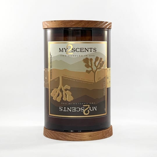 Joshua Tree Candle Co. creates jars of two scents in one, like this style with campfire and Joshua blossom smells.