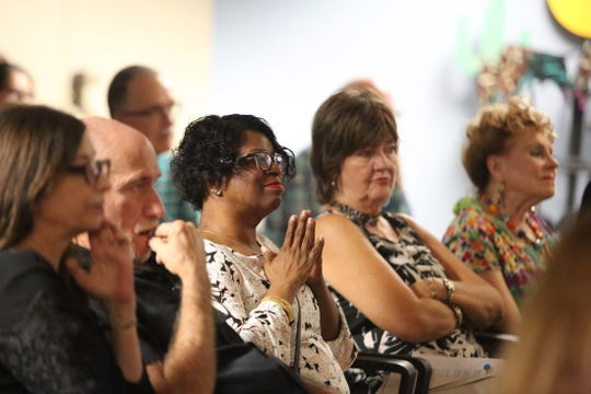 People listen as Randy Florence shares a story during the Coachella Valley Storytellers Project at The Desert Sun in Palm Springs, Calif., on Wednesday, September 25, 2019.