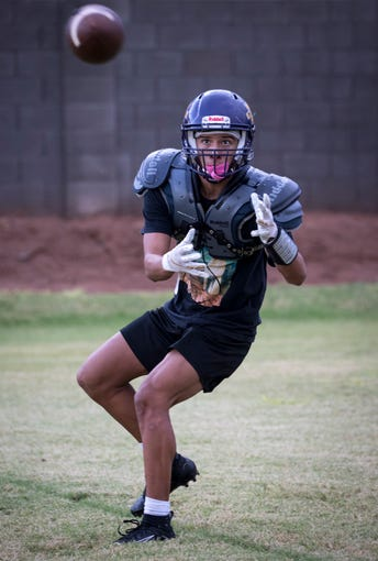 Chris Figueroa catches a pass, September 24, 2019, during practice at the Mesa High School football field, 1630 E. Southern Ave., Mesa.