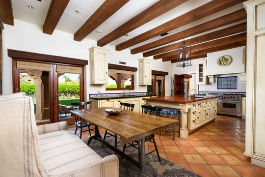 The $2.75M Paradise Valley mansion, sold by Lester Knispel, features a kitchen with wood beamed ceilings.