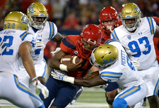 Will the Arizona Wildcats or UCLA Bruins prevail in their Week 5 Pac-12 college football game in Tucson on Saturday night?